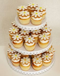 Cookie-topped cupcakes are double the sweetness. Presented on a tiered tray they double as festive decor.