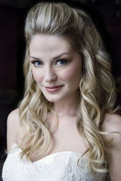 A half-up, half-down hairstyle created with a pouf on the top of the head and a set of loose beach Waves that fall over the shoulders| 20 Long #Wedding #Hairstyles 2013 | Confetti Daydreams