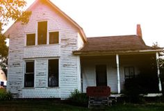 A Visit to the Ax Murder House ~ Villisca, Iowa, rests just off U.S. Highway 71, a quiet little town that in 1912 was the site of 7 brutal murders. The Moore family, & 2 of their children's friends staying the night, were bludgeoned by someone swinging an ax; someone who'd paced the attic smoking cigarettes, waiting for the family to come home from a June church picnic & go to sleep. The murders have never been solved.