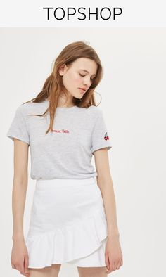 Denim mini ruffle skirt in white.