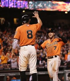 San Francisco Giants' Gregor Blanco, right, celebrates his two-run home run with teammate Hunter Pence during the fifth inning of a baseball game against the Milwaukee Brewers on Friday, Aug. 29, 2014, in San Francisco. (AP Photo/Marcio Jose Sanchez)
