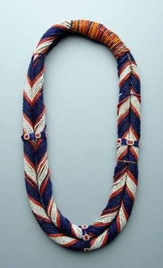 Necklace of two strands, i.e. rolls covered with glass beads of several colours and tdied together at the top. Nagaland: Konyak Naga people; mid 20th c. Shown in Truus Daalder, *Ethnic Jewellery and Adornment*, p. 340.