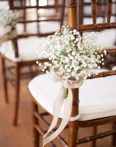Gentle bunches of baby's breath tied with soft burlap ribbon