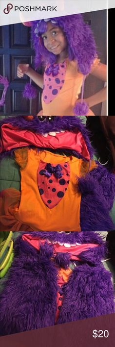 Cute Monster Costume. Size 10-12 Cute fluffy monster costume with leg warmers, hat, and dress. Costumes Halloween