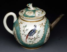 1770 A Worcester globular teapot and cover, decorated in the London ateilier of James Giles, fanciful birds perched on branches within gilt shaped reserves, the ground in turquoise, domed cover, flower finial, replaced silver spout, 15cm high, c.1770 (floral finial broken and cover re-glued) (see illustration) lot96 Bamfords