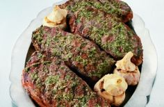 New York Steaks with Roasted Garlic Pesto from Weber Grills and Accessories: Recipe Courtesy of Jamie Purviance. **
