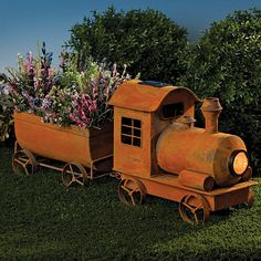 "Vintage Solar Train Planter, Item #47622, $59.99    Our rustic metal train planter will add a nostalgic touch to your patio or garden. The engine comes with a solar panel on the roof and an LED spotlight at the front. In the evening the lantern will automatically illuminate your garden. Plant your favorite flowers in the attached car for a unique conversation piece. Finished in a weathered ""rusted"" finish. Planter measures 10"" x 6¼"" x 6"". Engine measures 11"" x 12½"" x 7""."