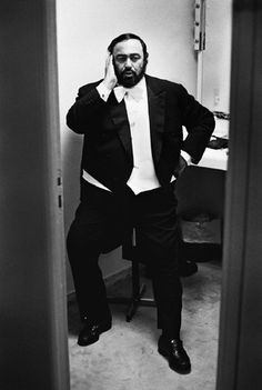 Luciano Pavarotti warming up before a performance - by Helmut Newton.