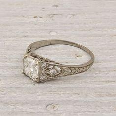 My engagement ring!  Made around 1920 or 30.  Asscher cut diamond on handmade platinum band.  I love it.