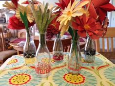 Lookit what my mama can do with scissors, milk bottles, and pretty paper!