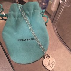 Tiffany and co. Mom pendant and chain. Gently worn and in great wearing condition for Mother's Day! Comes with pouch. %100 authentic. Has some minor scratches (shown) but has a ton of life and love to give. Chain is in great condition. Tiffany & Co. Accessories