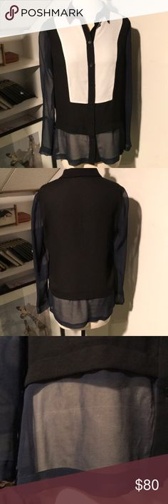 Yoga Azrouel color block shirt Beautiful silk black white and navy color block shirt. Arms and bottom are navy silk. Body is black and white in front and black in the back. Small horizontal linear pull on sheer bottom front as shown in third pic. Impossible to see if wearing a dark color behind it. Yigal Azrouel Tops
