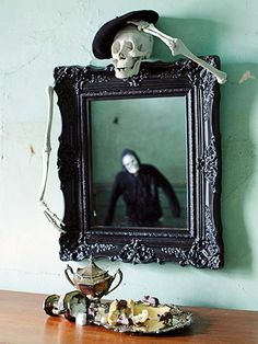 Haunted Reflection Mirror Decoration - Make no bones about it; this project is easy. Paint an ornate framed mirror black. Attach a skeleton head to the top and arms to sides of the frame. For an extra chill factor, position a ghost or skeleton figurine so it reflects in the mirror. Passersby will do a double take.