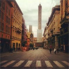 Via Rizzoli, You have no idea how happy I am to see Bologna's towers are still standing - Instagram by @bushbirdie