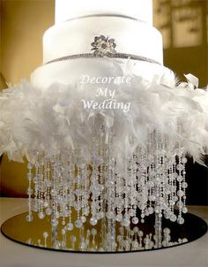 feather and rhinestone cake stand