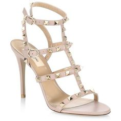 """rockstud leather sandals by Valentino. Stiletto sandals featuring studded straps design. Stiletto heel, 4.13"""" (105mm).Leather upper. Open toe. Adjustable ankle strap. Capra aegagrus hircus domesticated lining. Leather sole. Made in Italy. #valentino #nudeshoes #sandals"""
