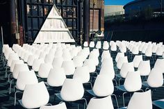 """How This Couple Avoided EVERY Wedding Trend Out There #refinery29 http://www.refinery29.com/industrial-san-francisco-wedding#slide-1 The sleek, white chairs provided a touch of modern decor against the industrial backdrop.""""Randomly, finding the perfect chairs was a big deal for me,"""" says Ceccarelli. """"I wanted low-impact, modern chairs that didn't read too techie. I searched everywhere and when I found those bad boys, I knew they would be the perfect counterpoint for the masculine, edgy…"""