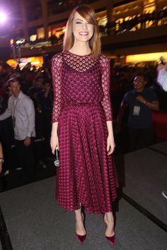 Emma Stone teamed a Dior dress with Christian Louboutin heels.