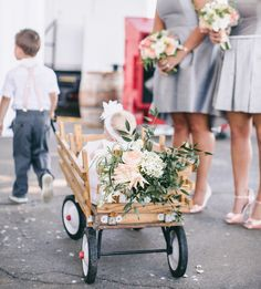 Flowers added to flower girls wagon. Courtesy of Scott Andrew photography.