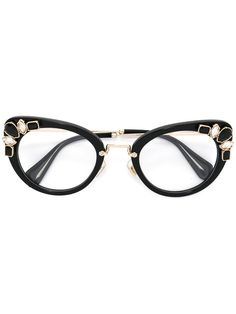 9290265cfd59 Miu Miu Eyewear cat eye glasses Swarovski Sunglasses