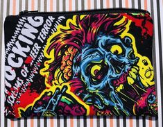 Handmade zipper pouch with colorful zombies.
