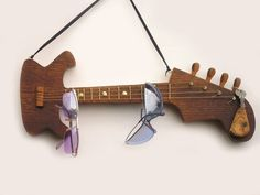 Stop the madness of misplacement for your music lover. This guitar holder isn't just a pretty piece, but holds your sunglasses, keys, and maybe even your hand one day.