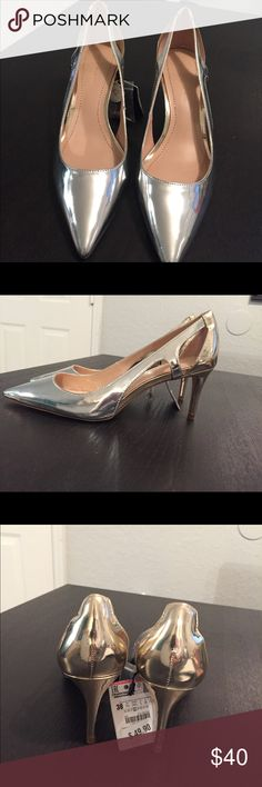 Zara cut out med hight silver heel Beautiful never worn NWT silver heels. A few small marks on them. Beautiful cut outs. Easy to walk height. Great for office or party. Pleas make an offer Zara Shoes Heels