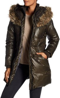 e6394f2c29e1 The perfect outerwear coat for the winter with an attached faux fur hood,  adjustable waist belt, and zip closure. Dry clean Shell  100% polyesterFaux  fur  ...