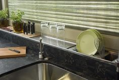 A built-in dish-drying rack and knife block. Photo: kitchenbathartisans