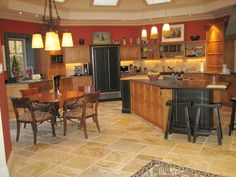 Gail Whiting's designed her kitchen with custom cabinets, counter tops that are a mix of wood and pietra cardosa and black onyx honed, and a custom made copper top table.