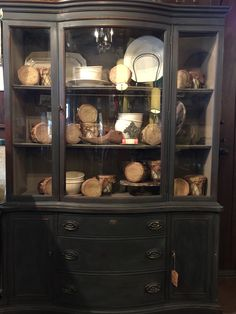 China cabinet painted with Annie Sloan Chalk Paint® Graphite and Coco on the interior