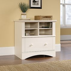 Sauder Harbor View Locking drawer with full extension slides holds letter, legal, or European size hanging files.  Cubbyhole storage features two adjustable shelves.  Quick and easy assembly with patented T-lock drawer assembly system.  Antiqued White finish.