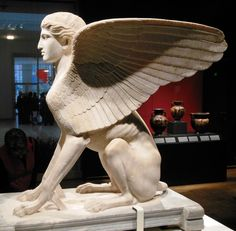 In Greek mythology, the sphinx combined the head of a woman, body of a lion, and wings of an eagle. The sphinx, as guardian of the tomb, was often featured on grave markers. The sphinx shown above is actually Roman, made about 120-140 CE, and probably used as a table support.