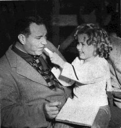 Shirley Temple and director,1936.