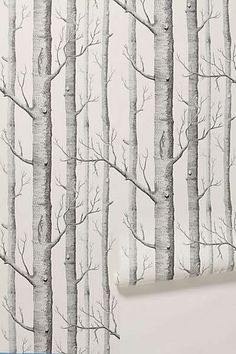 Anthropologie - Woods Wallpaper. Can't do the walls but I'd love to do a few big sheets of plywood to prop behind the headboard. Maybe with light teal wall behind.