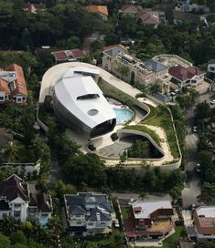 Luxury House - modern design by French architects (Paris firm Jouin Manku).  You have to click on the link to see the full glory of this house.  It's in Kuala Lampur and houses 3 generations of family.  pimp!