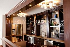 Note:  Refrigerator is across from bar:  balanced against other column?  Otherwise, bar will work