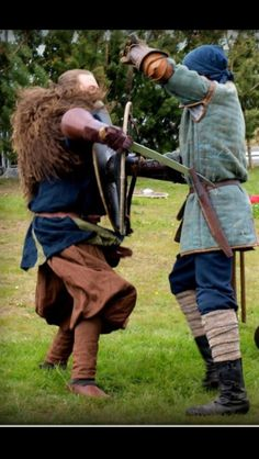 Viking fight... Well, in reenactment you use blunt swords, and just pretend... otherwise the guy on the right would be on his way to Valhalla!