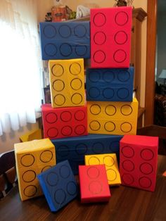 I made these ginormous Legos out of empty boxes and Dollar Tree table clothes for Logan's birthday.