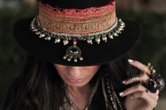 Nice contrast. fabric and jewelry on a plain black hat. (Be prepared to get it dusty).