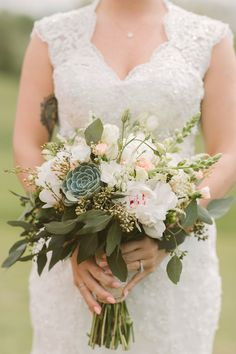 peony, seeded eucalyptus, and succulent bouquet, photo by Hot Metal Studio http://ruffledblog.com/white-barn-wedding #flowers #weddingbouquet