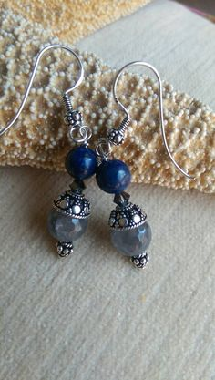 Check out this item in my Etsy shop https://www.etsy.com/listing/260776800/stunning-blue-and-gray-drop-earrings-of