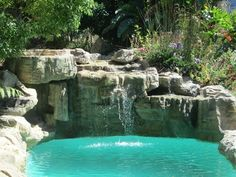 Sandstone waterfall embankment on swimming pool. One of the best rock sculptures ever.