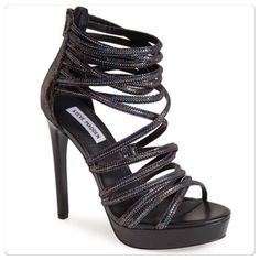 "♣️ Steve Madden ""Tubing"" Platform Sandal Steve Madden Platform Sandal. Shimmery scales illuminate the intertwined straps of a dramatic modern platform sandal. 5"" heel, 1 1/4""  platform, 4 1/2"" ankle strap height, back zip closure, synergic upper, leather lining, synthetic sole. Run true to size.   All items are from a clean, smoke free home  We ❤️ offers but will only be considered by using the ""OFFER"" option  Trades  Modeling Steve Madden Shoes Heels"