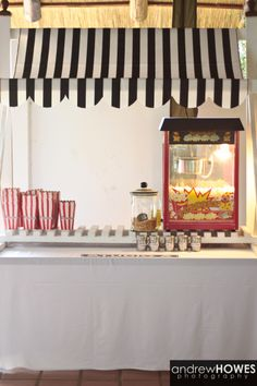 The Popcorn Booth at our wedding - no movie themed wedding could be held without a Popcorn Booth.  Popcorn Booth supplied by Candy Saloon of Johannesburg, South Africa.