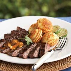 Grilled Skirt Steak with Chili-Lime Butter (Williams Sonoma)- Ingredients: 4 Tbs. (1/2 stick) unsalted butter, at room temperature 1 tsp. chili-lime rub 1 1/2 to 2 lb. skirt steak, trimmed of excess fat 1 Tbs. olive oil Salt and freshly ground pepper, to taste. Serves 6.