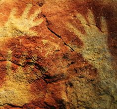 """Altamira Cave.  Paleolithic handprint paintings, created when the painter spit pigment out of his mouth, around his/her hands.  Earliest """"airbrushing""""...so to speak!"""