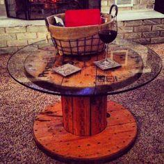 DIY Spool coffee table!! Just add a little stain, and a glass top and viola!!