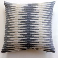 Merino Lambswool Cushion – Grey Beacon: This beautiful double-sided cushion made from soft merino lambswool comes with a different pattern on either side. Designed by Kerry Stokes in Brighton, and made in Wales. The design 'Beacon' takes us to the Sussex countryside again with its undulations and distant sea-scapes.