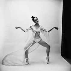 1966 by Cecil Beaton    New York City Ballet dancer Mimi Paul standing 'on point,' knees flexed, wearing her costume for 'Bugaku': Japanese lacquered wig and sheer coat with butterfly sleeves worn over a bikini.